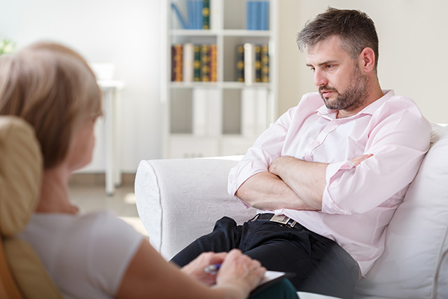 Man receiving counselling from a City College Programs Disability Counselling graduate