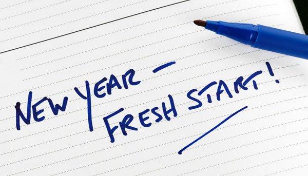 A new year, a fresh start written on paper in blue pen